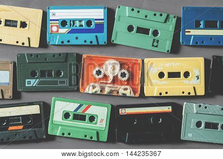 Old cassette tapes on gray wooden table top view