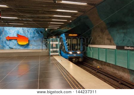 STOCKHOLM-SWEDEN-2014-04-26.Train is coming. Stadion metro station is on the red line of the Stockholm metro located in the district of Ostermalm.The station was opened in 1973.