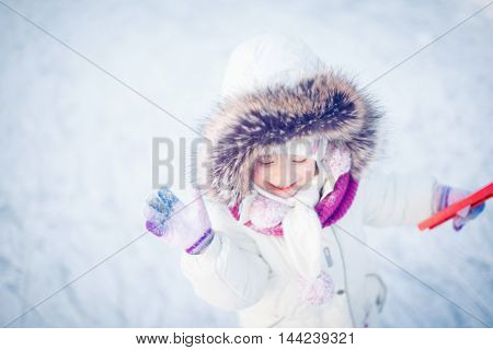 Children play outdoors in snow.Outdoor fun for family Christmas vacation.