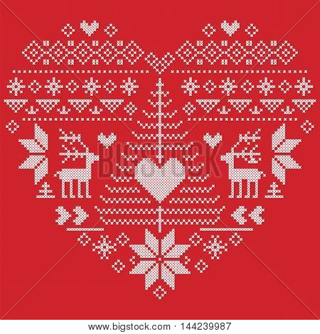 Heart Shape Scandinavian Printed Textile  style and inspired by  Norwegian Christmas and festive winter seamless pattern in cross stitch with Christmas tree, snowflakes, reindeer,  heart and ornament on red background