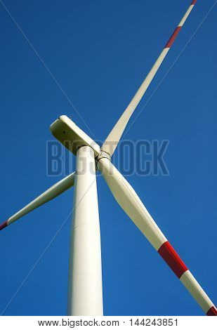 detail of wind turbine in blue sky