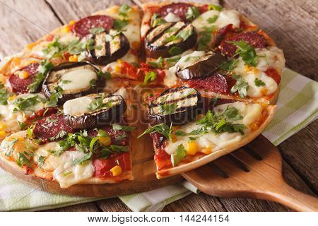 Italian Pizza With Eggplant, Salami, Corn And Mozzarella Close Up. Horizontal