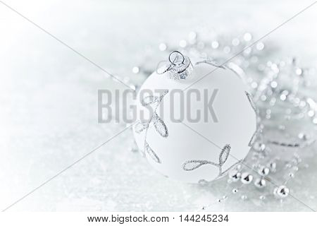 White and Silver Christmas Decorations on a Wooden Background