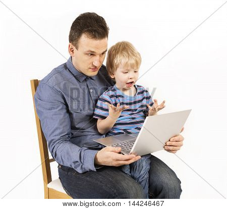 Father and son with the laptop. Family and computers