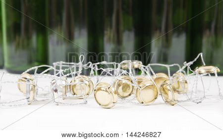 Wire hood.Capsules of a bottle of champagne background