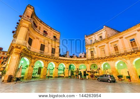 Martina Franca Puglia in Italy. Piazza Plebiscito and Basilica di San Martino at twilight. Apulia Bari region in Italia.