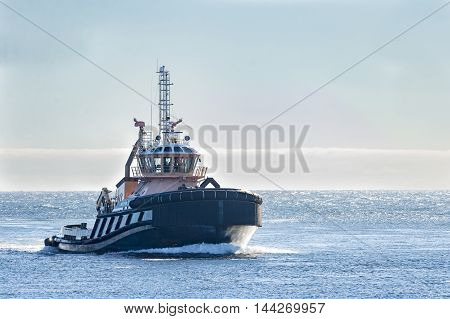 Sandwich Massachusetts USA - September 14 2014: Tugboat returning from trip onto choppy Cape Cod Bay