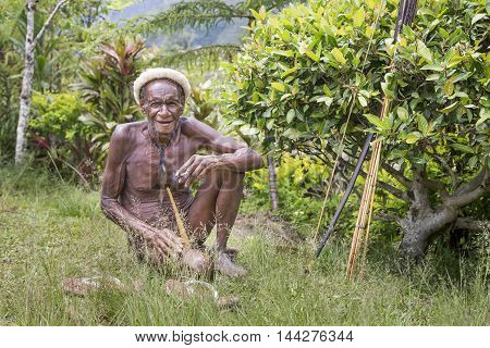 Baliem Valley West Papua Indonesia February 15th 2016: Dani tribe man smoking