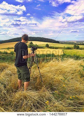 Man taking panoramic landscapes in Sudety Range, Poland