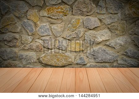stone wall background with wooden slats floor