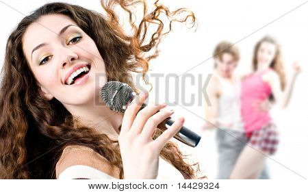 pretty girl singing at the revelry party