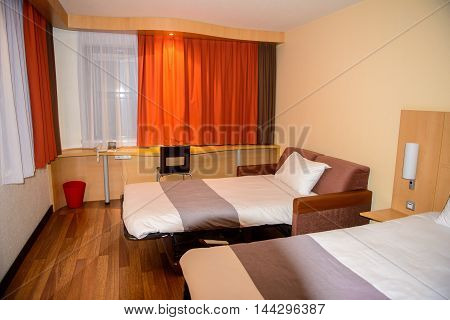 BUDAPEST, HUNGARY - AUGUST 18, 2014: Room in the  Ibis hotel on the Heroes Square in Budapest, Hungary. ibis is an international hotel company, owned by Accor hotels.