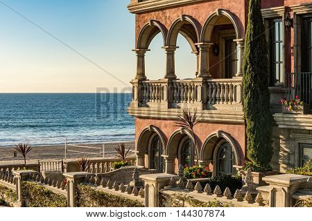 Los Angeles - December 17, 2015: Beach boardwalk in California by Italian style house in Manhattan Beach