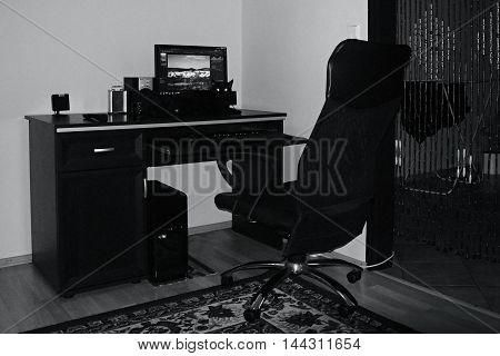 2016/07/30 Chomutov Czech republic - black cat lying on a table oversees postprocessing in Zoner Photo Studio program