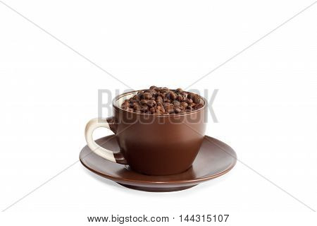 Cup full of roasted coffee beans isolated over white background