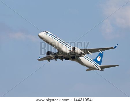 Moscow - July 31 2016: Large passenger aircraft Embraer ERJ-195LR (190-200LR) Belavia Airlines flies to Domodedovo airport and on a background of blue sky July 31 2016 Moscow Russia