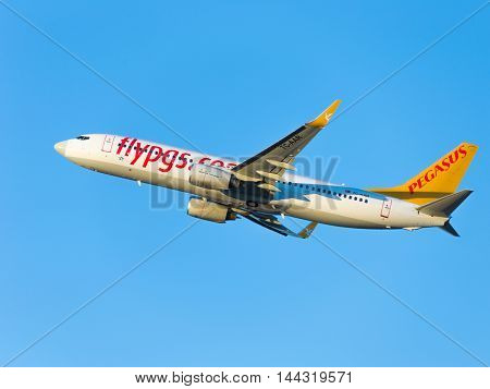 Moscow - August 20 2015: A passenger plane Boeing 737-86N (W) Pegasus Airlines flies to Domodedovo airport and on a background of blue sky August 20 2015 Moscow Russia