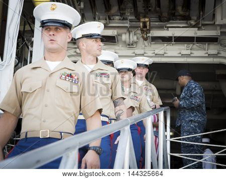 NEW YORK MAY 26 2016: Military personnel line up to disembark the the USS Bataan (LDH 5) an amphibious assault ship moored at Pier 88 during Fleet Week NY 2016.