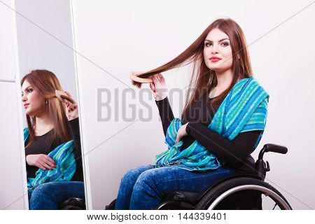 Disabled Girl Looking At Mirror.