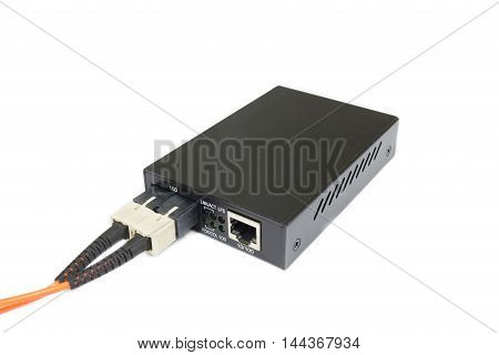 Fiber optic Media converter with metallic RJ45 connector and SC fiber Optic connector isolated on white background. Clipping path for use