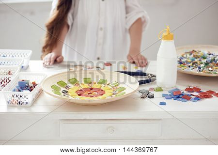 workshop of decorating with colorful glass mosaic in white studio