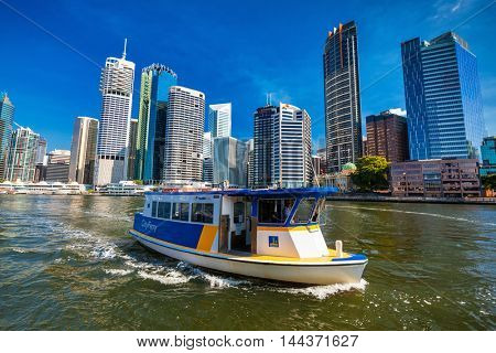 BRISBANE, AUS - AUG 10 2016: City Ferry on the river in Brisbane, with the skyline in the background