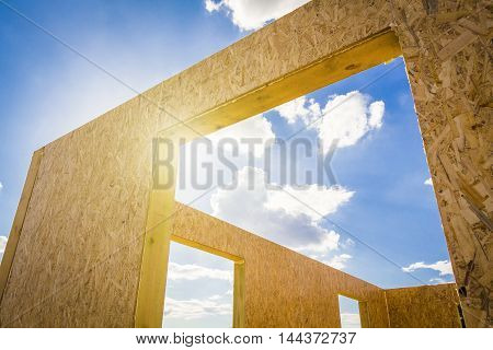 Part of a wooden being built house from SIP panels closeup.