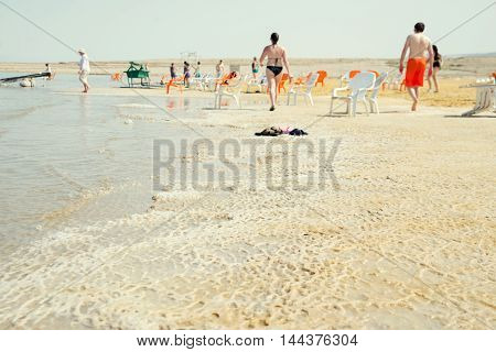 People rest at the Dead Sea in Israel