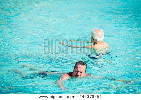 BUDAPEST, HUNGARY - AUG 18, 2014: Unidentified man  swims in a pool of the Szechenyi Medicinal Bath complex , the largest medicinal bath in Europe, built in 1913