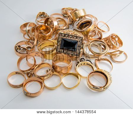 heap of gold jewelry on a white background