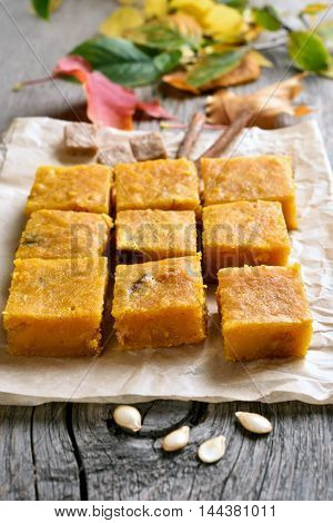 Vegetarian dessert pumpkin squares on wooden background
