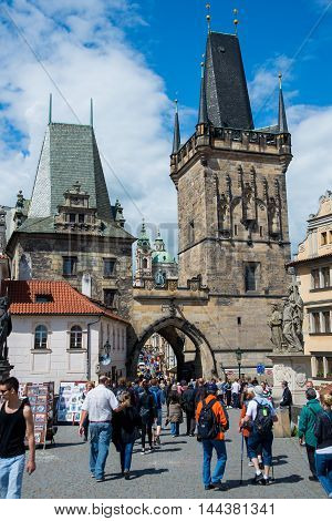 PRAGUE, CZECH REPUBLIC - MAY 6, 2015: The popular tourist itinerary in Prague on the Charles Bridge