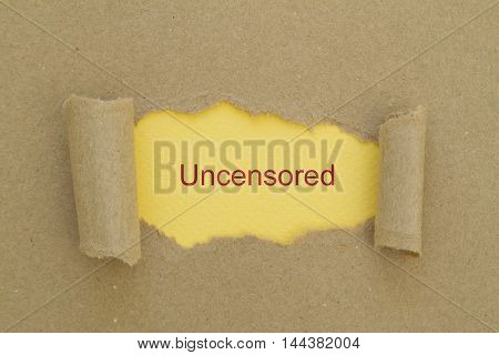 uncensored word written under torn paper .