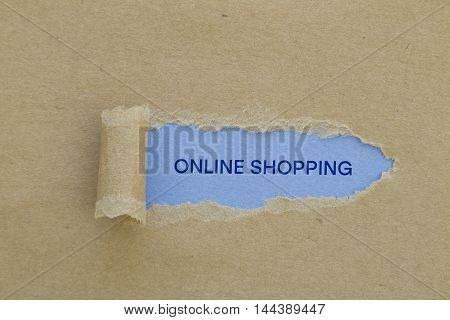 Online shopping written under torn paper .