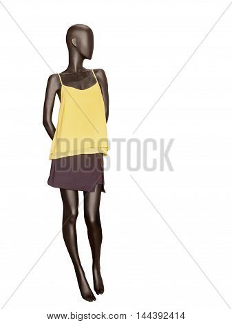 Female mannequin dressed in skirt and yellow top isolated on white background. No brand names or copyright objects.