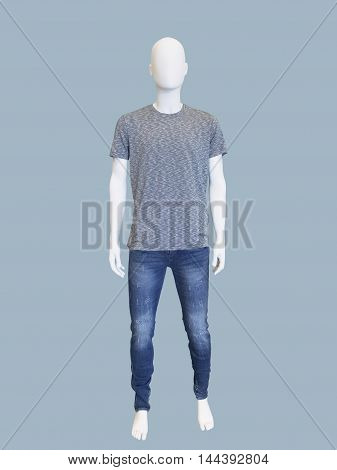 Full length male mannequin dressed in t-shirt and jeans isolated on blue background. No brand names or copyright objects.