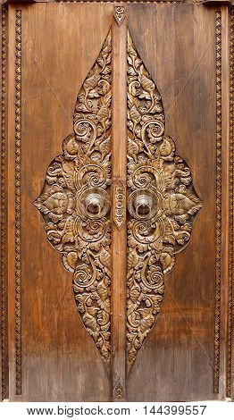 Antique wooden door with floral carvings in oriental style
