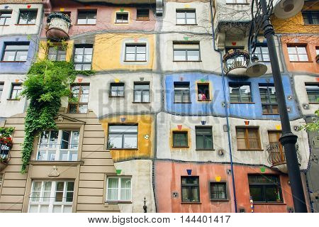 VIENNA, AUSTRIA - JUN 12, 2016: Surreal apartment house built with concept of Austrian artist Hundertwasser on June 12, 2016. Hundertwasserhaus built at 1985 and became the cultural heritage
