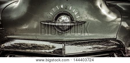 Leland, Michigan, USA - August 26, 2016: The hood ornament of a classic 1950's Oldsmobile Eighty Eight.
