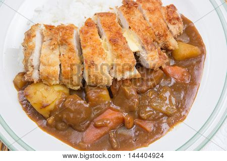 Fry pork tongkatsu Japanese curry with rice / Cooking Japanese Curry concept