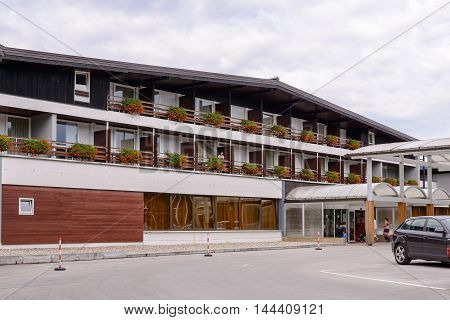 PLTVICE LAKES NATIONAL PARK AREA, CROATIA - AUGUST 19, 2014: Hotel Jezera which is located in the central zone of the Plitvice Lakes National Park, which is a UNESCO World Heritage