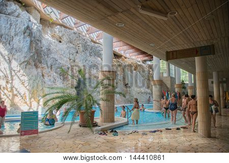MISKOLC, HUNGARY - AUG 29, 2014: Unidentified people swim in a pool in the Barlangfurdo, a thermal bath complex in a natural cave in Miskolctapolca, which is part of the city of Miskolc, Hungary