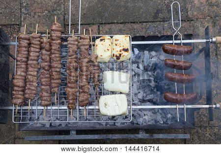 shot of a family bar-b-que Greek style, with halumi, sausages and chicken hearts