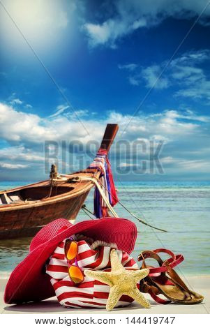 Beach bag on the beach with Thai long tail boat