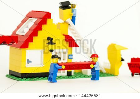 Orvieto, Italy - February 12th 2015: Construction site of Lego, Workers build a house. Lego is a popular line of construction toys manufactured by the Lego Group