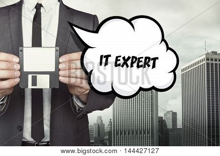 IT Expert text on speech bubble with businessman holding diskette