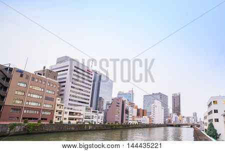 Osaka, Japan - March 10, 2016: Business building standing along the canal in Umeda financial area.