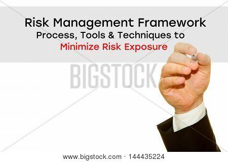 Businessman hand writing Risk Management Framework. Process, Tools & Techniques to Minimize Risk Exposure. Risk Management concept.