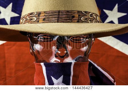 glass head wearing cowboy hat and rebel flag scarf with confederate flag background