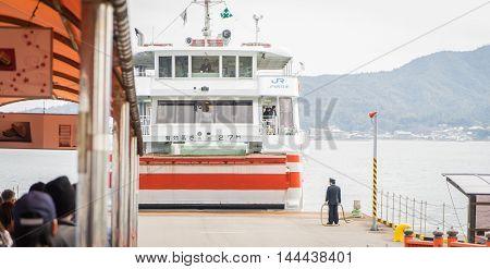 Hiroshima, Japan - March 16, 2016: Miyajima on March 16, 2016. Tourists are waiting to board the JR Ferry to Miyajima.